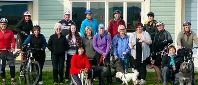 Mountain Biker and Walker +Dogs